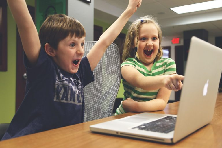 Kids at Play with a laptop - All Things Scene at work